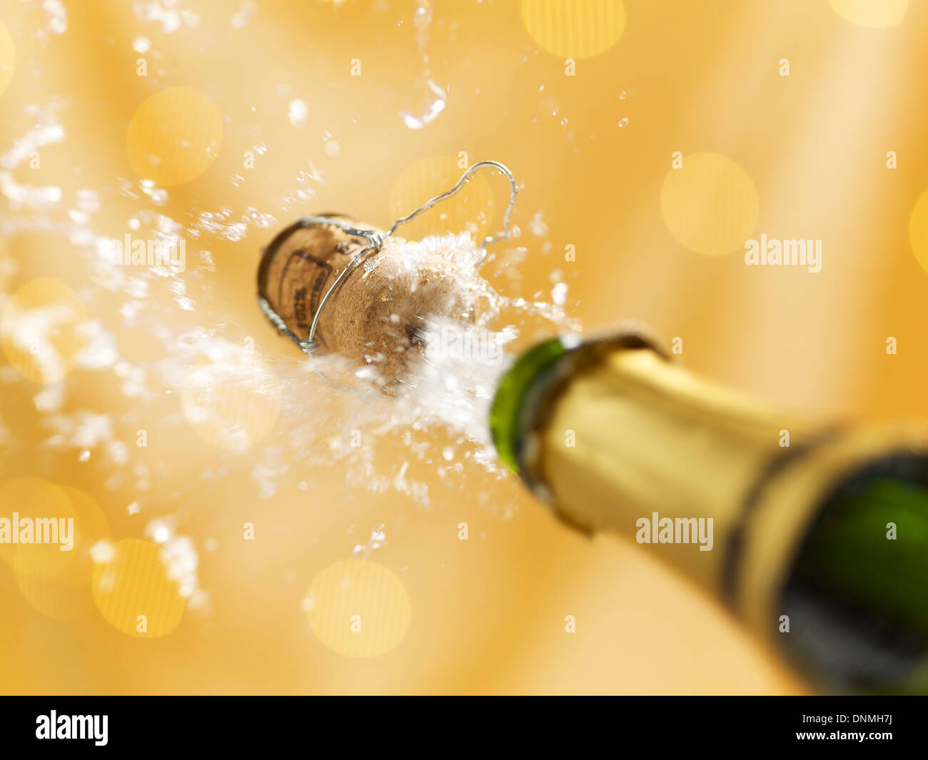Uncorking a bottle of champagne - Stock Image