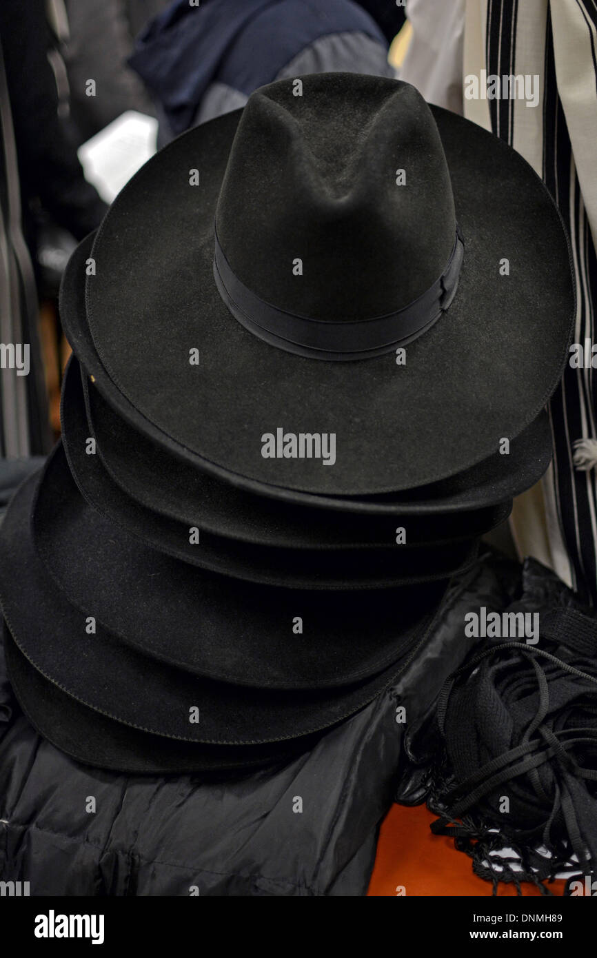 A pile of black hats of the same style worn by Lubavitch Hasidic Jews in Crown Heights Brooklyn, New York - Stock Image