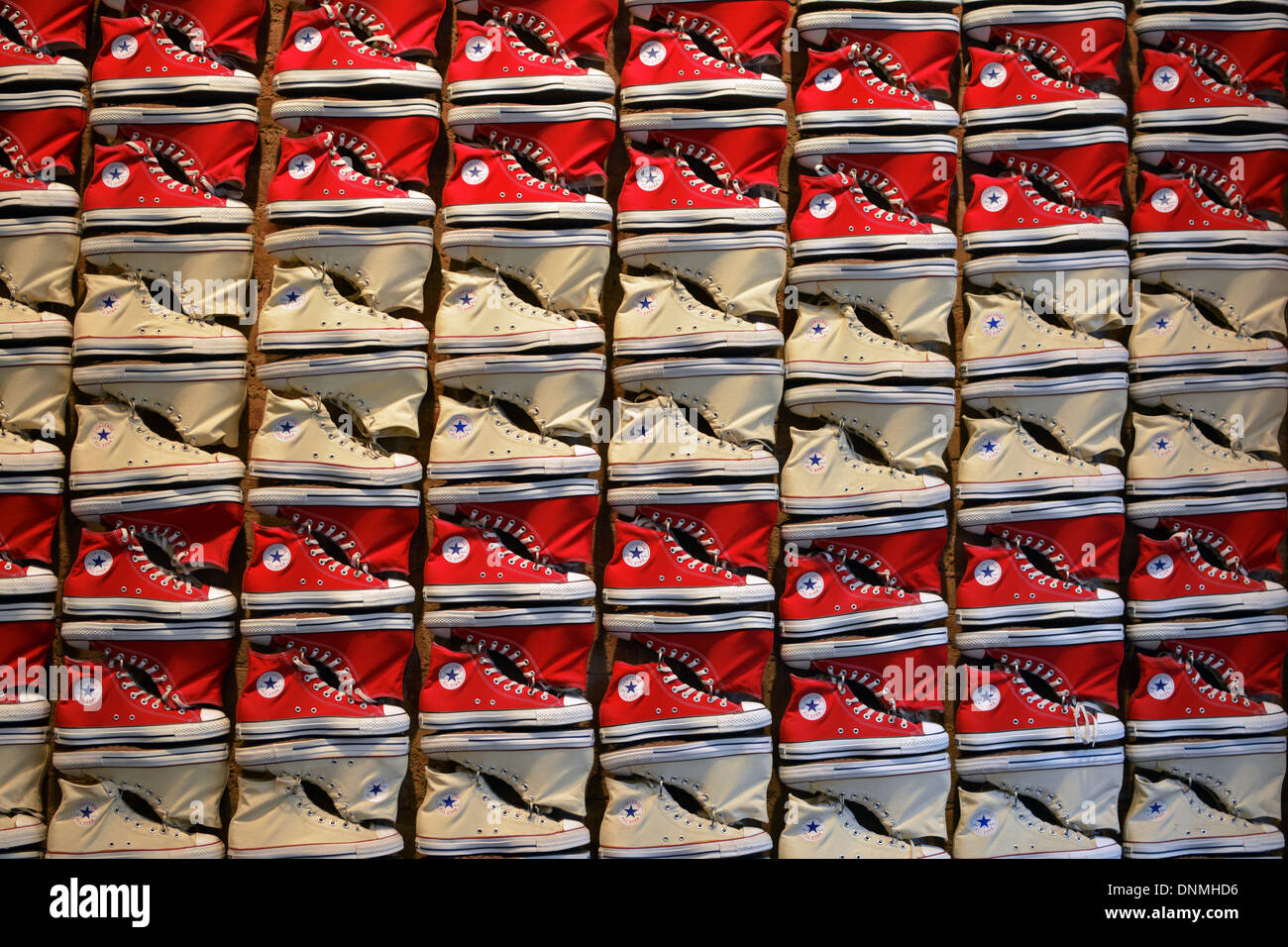 Converse sneakers laid out in the pattern of an American flag at the Converse store on Broadway in Greenwich Village, Stock Photo