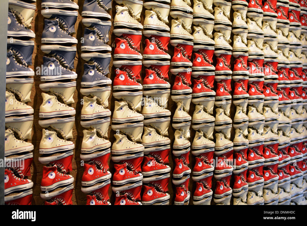 ba6a86c47007 Converse sneakers laid out in the pattern of an American flag at the Converse  store on