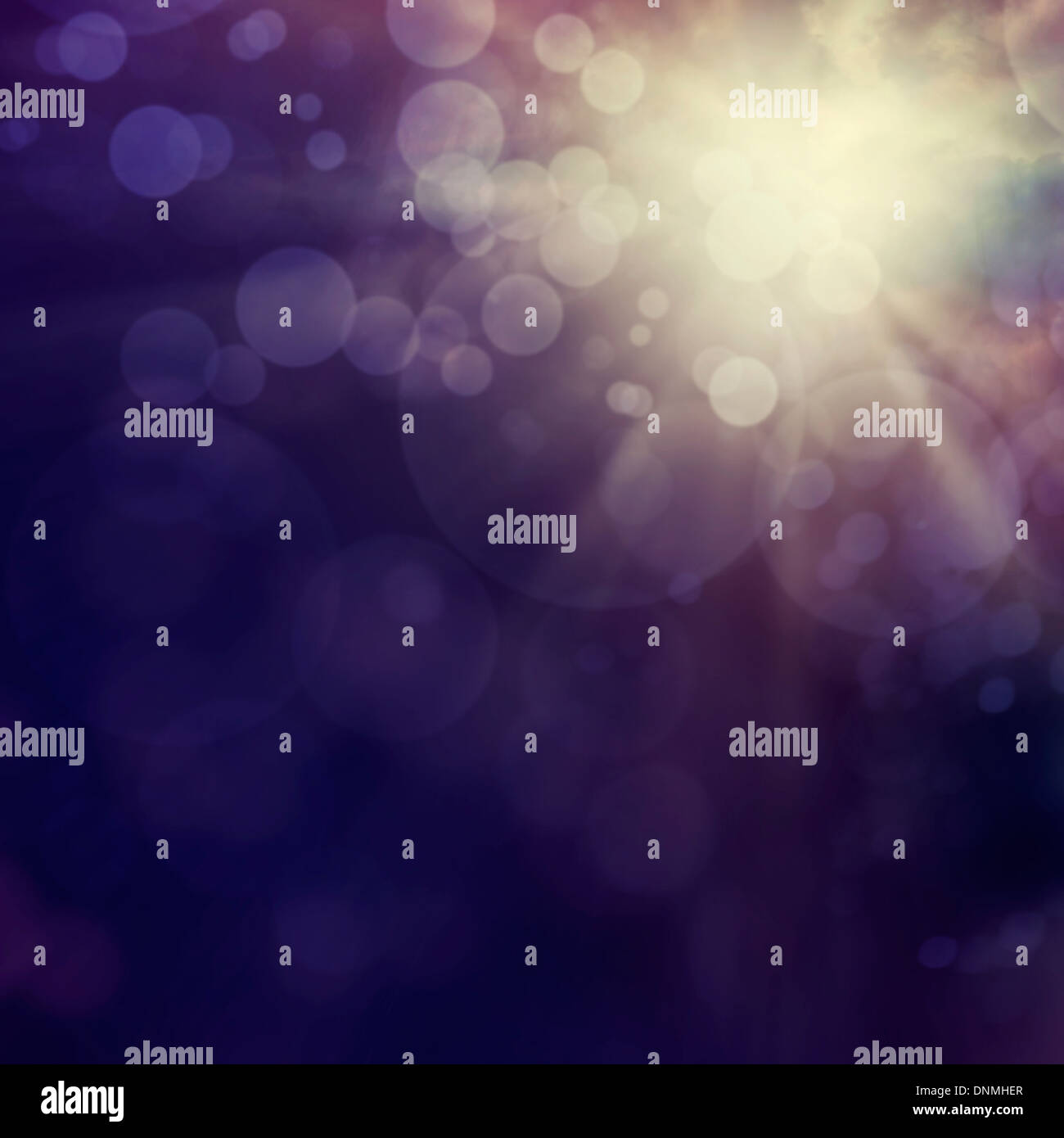 Purple Festive Christmas abstract background with bokeh lights. - Stock Image
