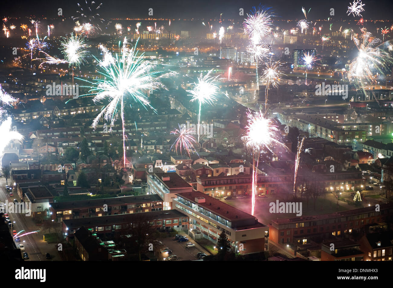 Fireworks on new years eve as seen from a 101 meters high building in the center of Enschede in the Netherlands - Stock Image