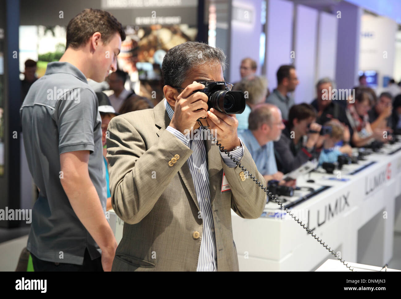Berlin, Germany, visitors at the booth of Panasonic at IFA 2013 - Stock Image