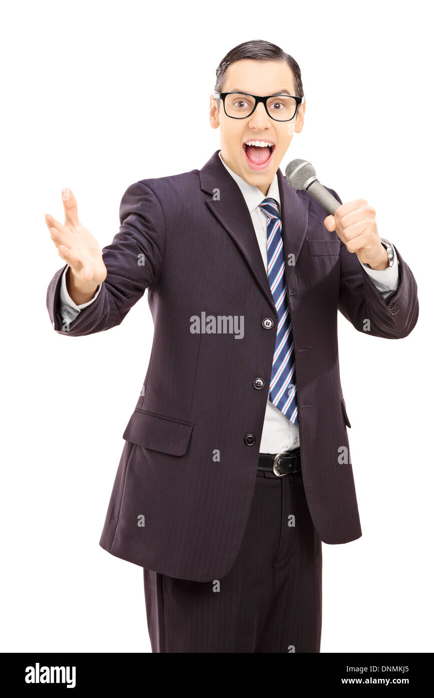 Professional male reporter in black suit holding a microphone - Stock Image
