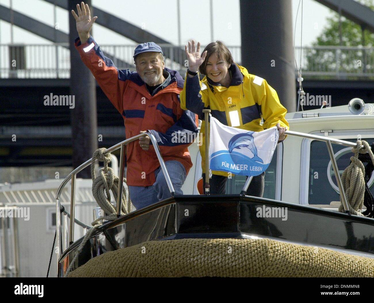 FILE - A file photo gated 08 May 2001 shows circumnavigator Rollo Gebhard with his wife Angelika on his boat 'Solveig VII' in the port of Hamburg, Germany. Rollo Gebhard died on 27 December 2013 at the age of 92 in his home in Bad Wiessee at Tegernsee Lake. The author, photographer and dolphin conservationist, circumnavigated the globe in a sailboat twice in 1967 to 1970 and 1975. The first German to do this alone. Photo: KAY NIETFELD - Stock Image