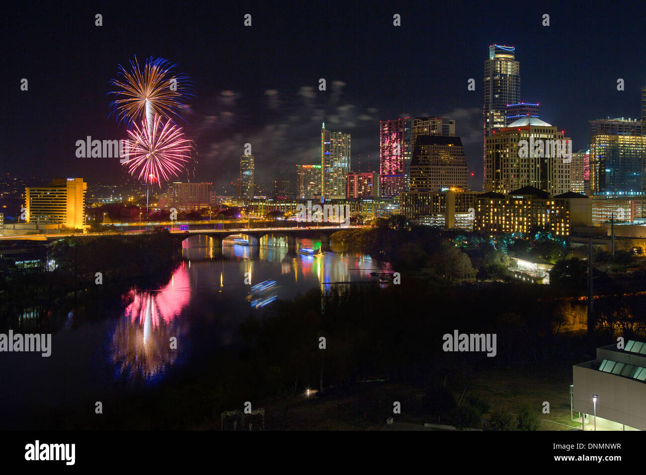 Fireworks explode over the Austin, Texas skyline on New Year's Eve as revelers say goodbye to 2013 and hello to 2014. - Stock Image