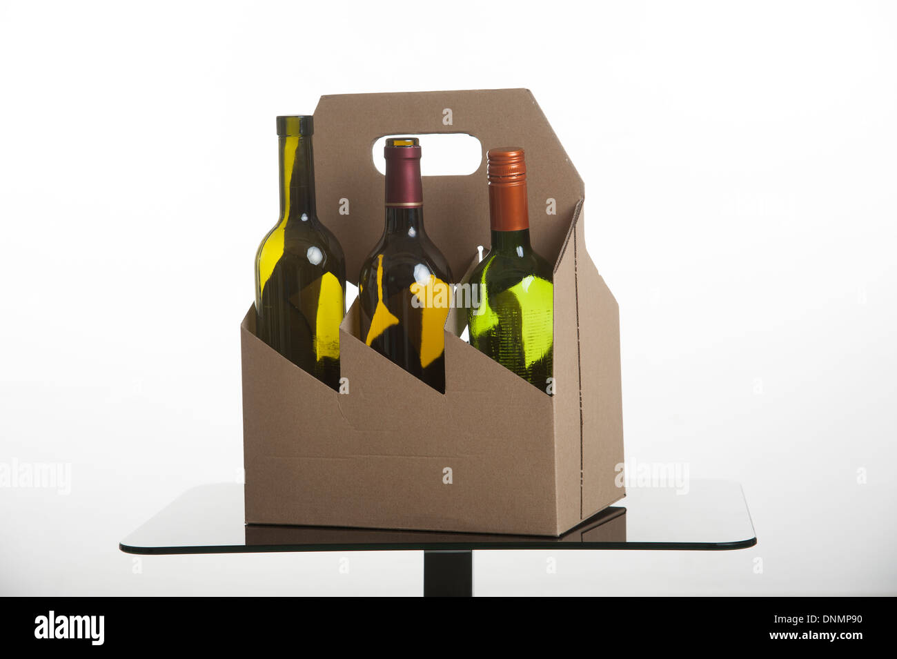Cardboard wine bottle carrier both items suitable for recycling - Stock Image