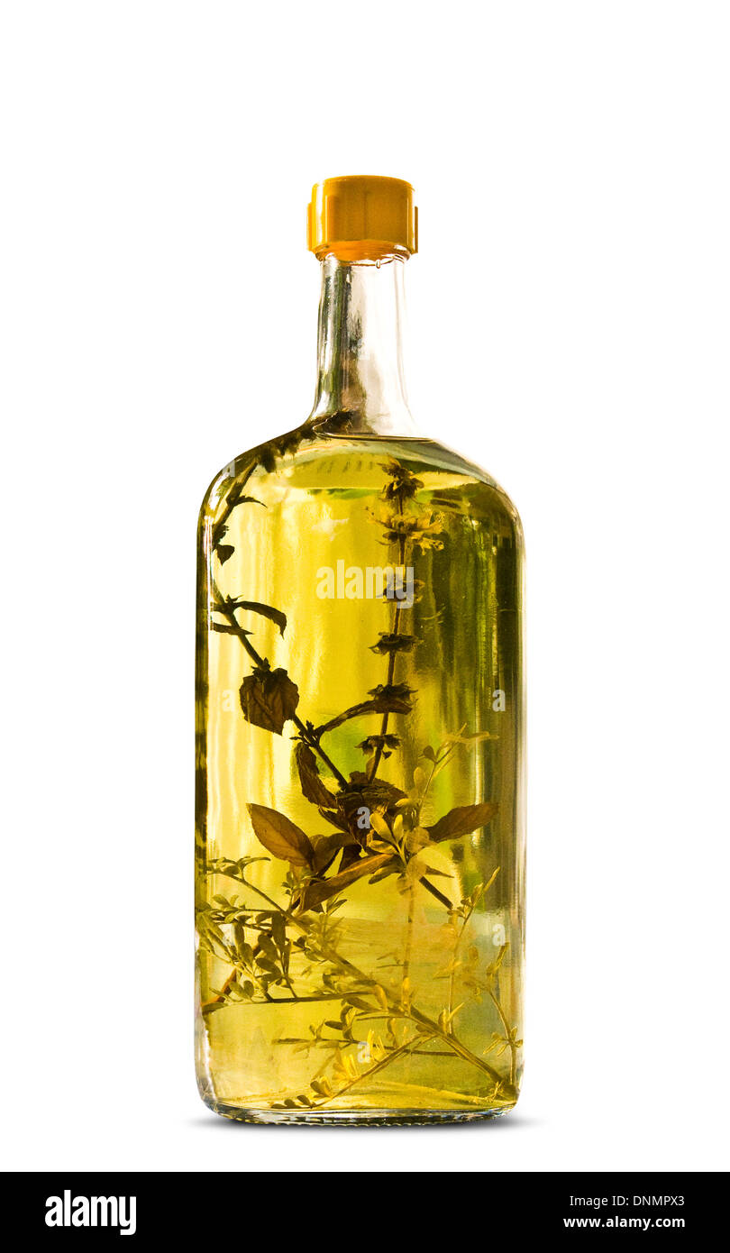 Bottle of herb brandy (rakia) from Croatia on a white background. - Stock Image