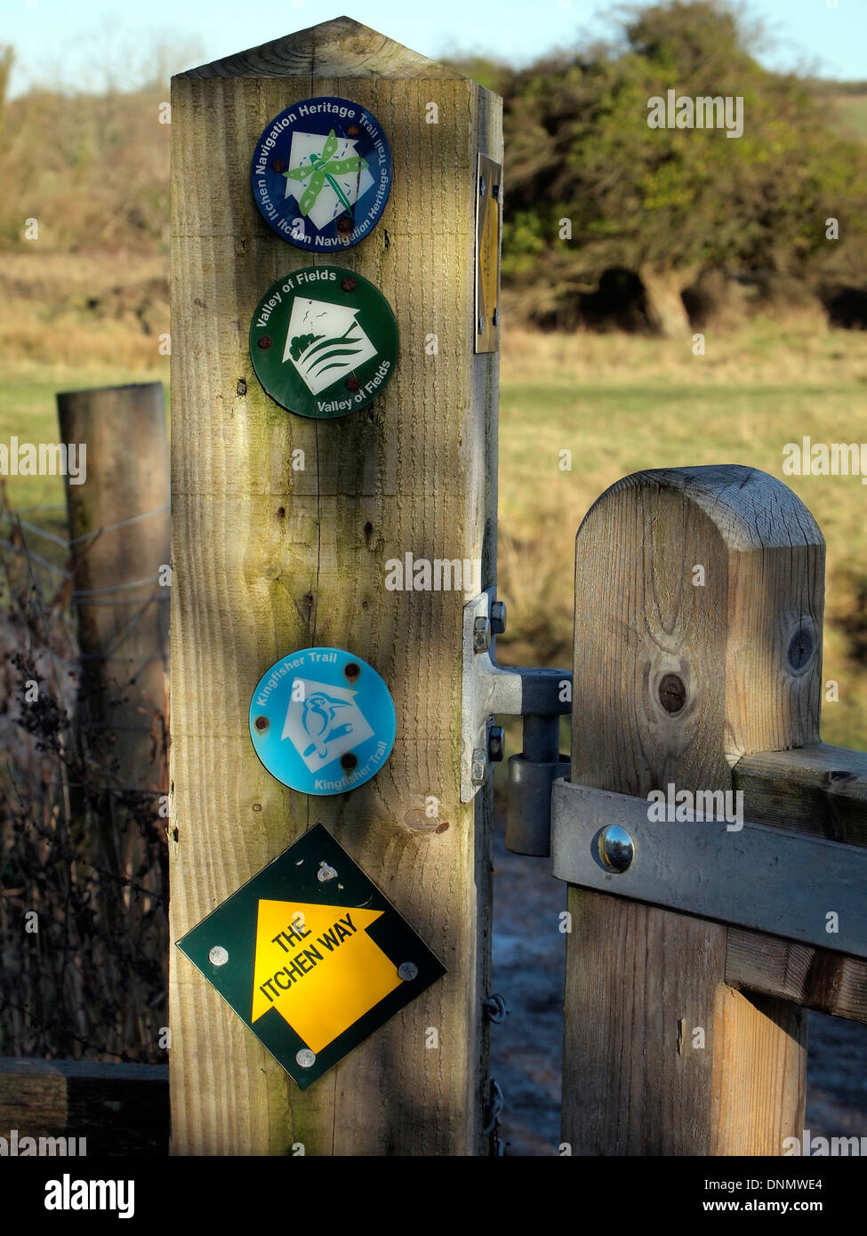 Footpath signs at a gate on the Itchen Way footpath near Shawford showing the various routes available to walkers. - Stock Image