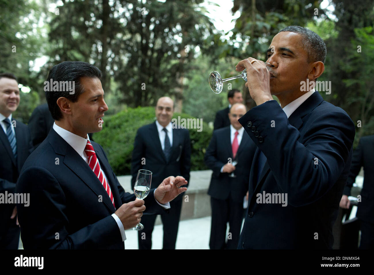 US President Barack Obama tastes a sip of tequila as the urging of President Enrique Pena Nieto of Mexico prior to a working dinner at Los Pinos May 2, 2013 in Mexico City, Mexico. - Stock Image