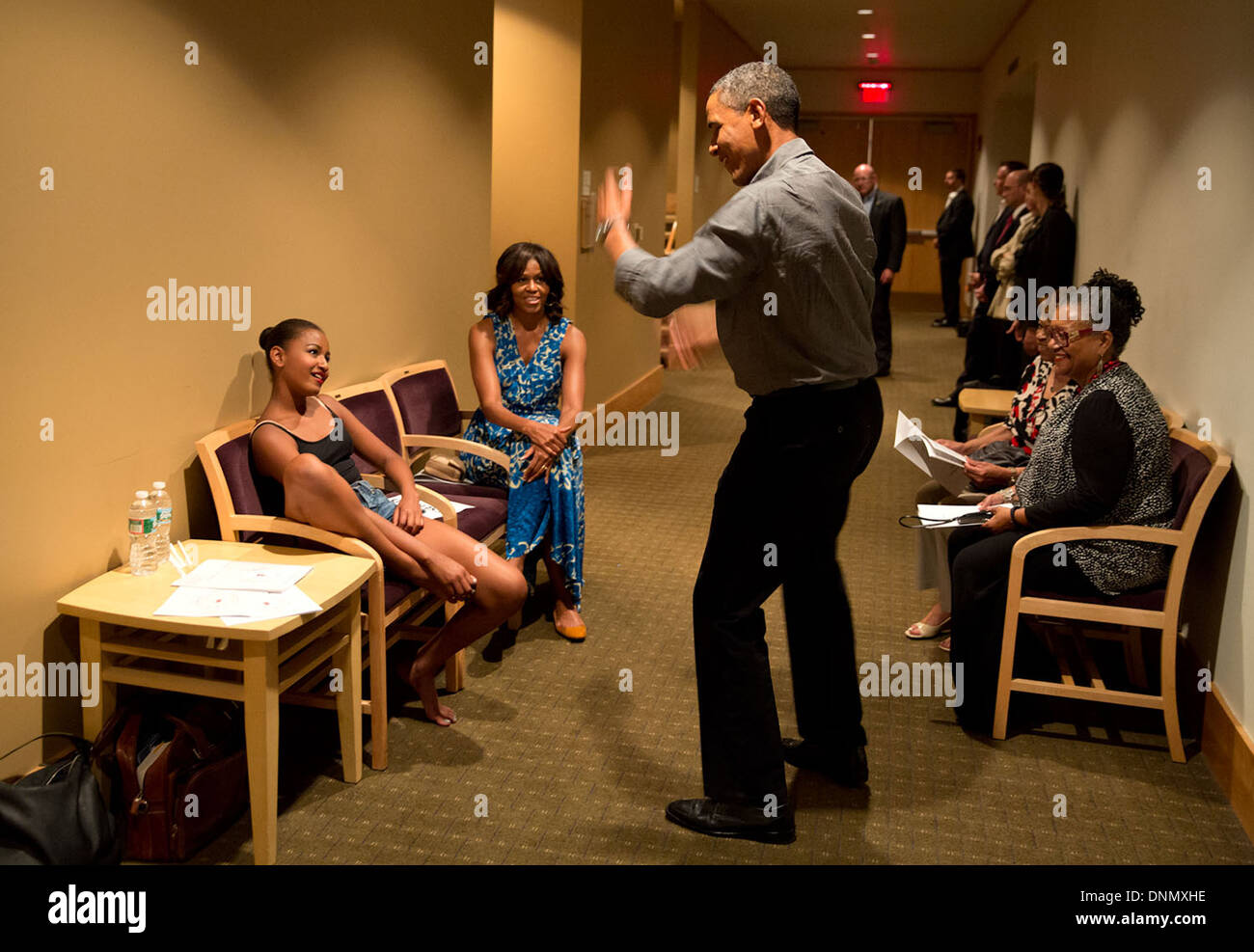 US President Barack Obama shows off his dance moves as he and the First Lady waited backstage during an intermission of daughter Sasha's dance recital at Strathmore Arts Center June 16, 2013 in North Bethesda, Maryland. - Stock Image