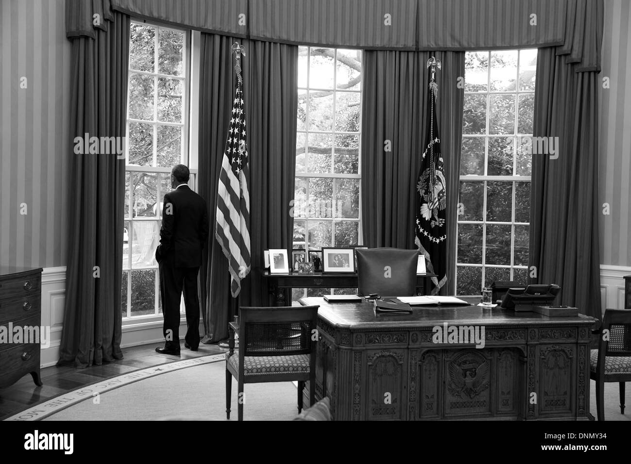 US President Barack Obama looks out the window of the Oval Office August 29, 2013 in Washington, DC. - Stock Image