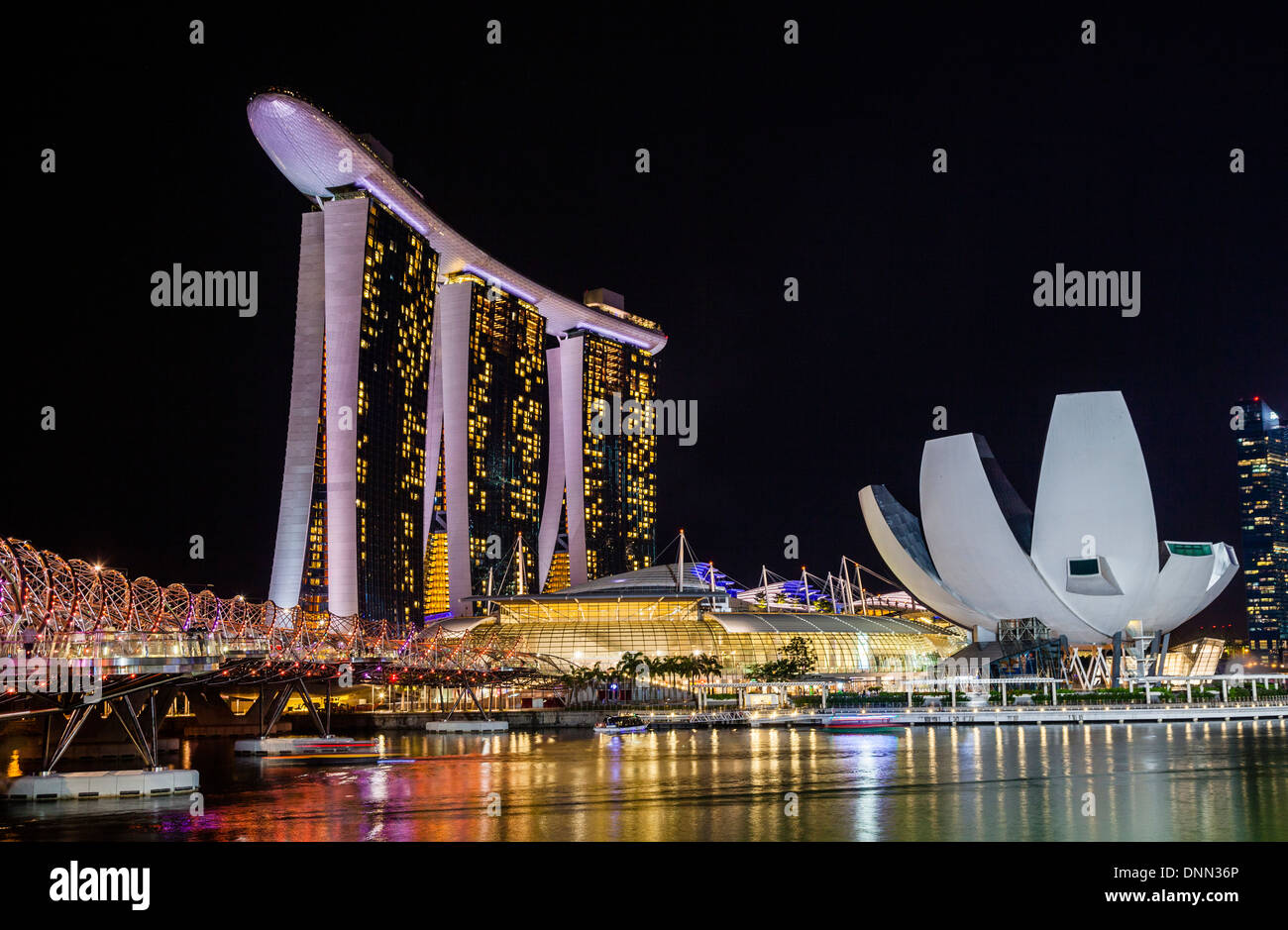 Singapore, night view of Marina Bay Sands, Art Science Museum and the Helix Bridge - Stock Image