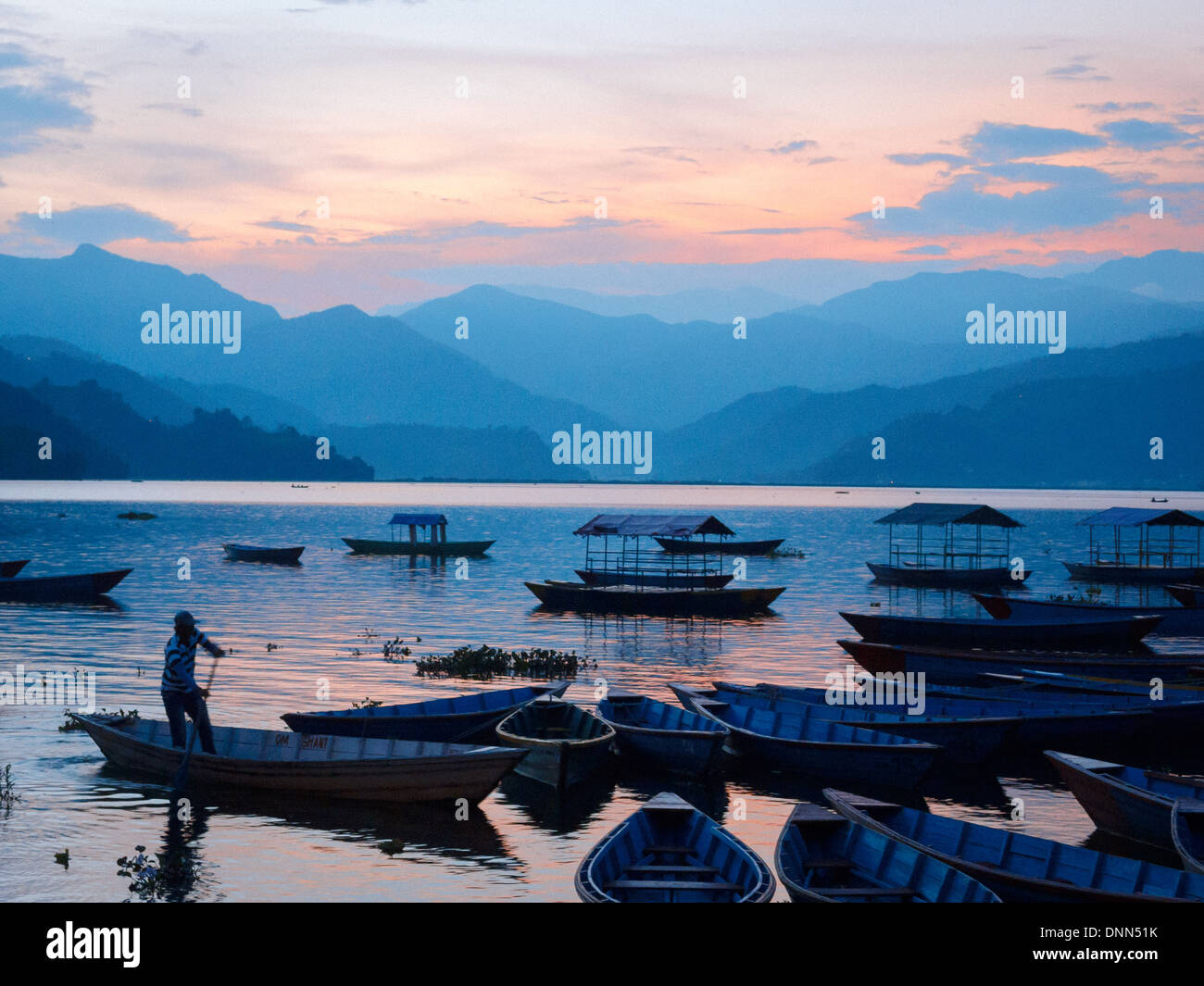 Boats on Fewa Tal at dusk, Pokhara, Nepal - Stock Image