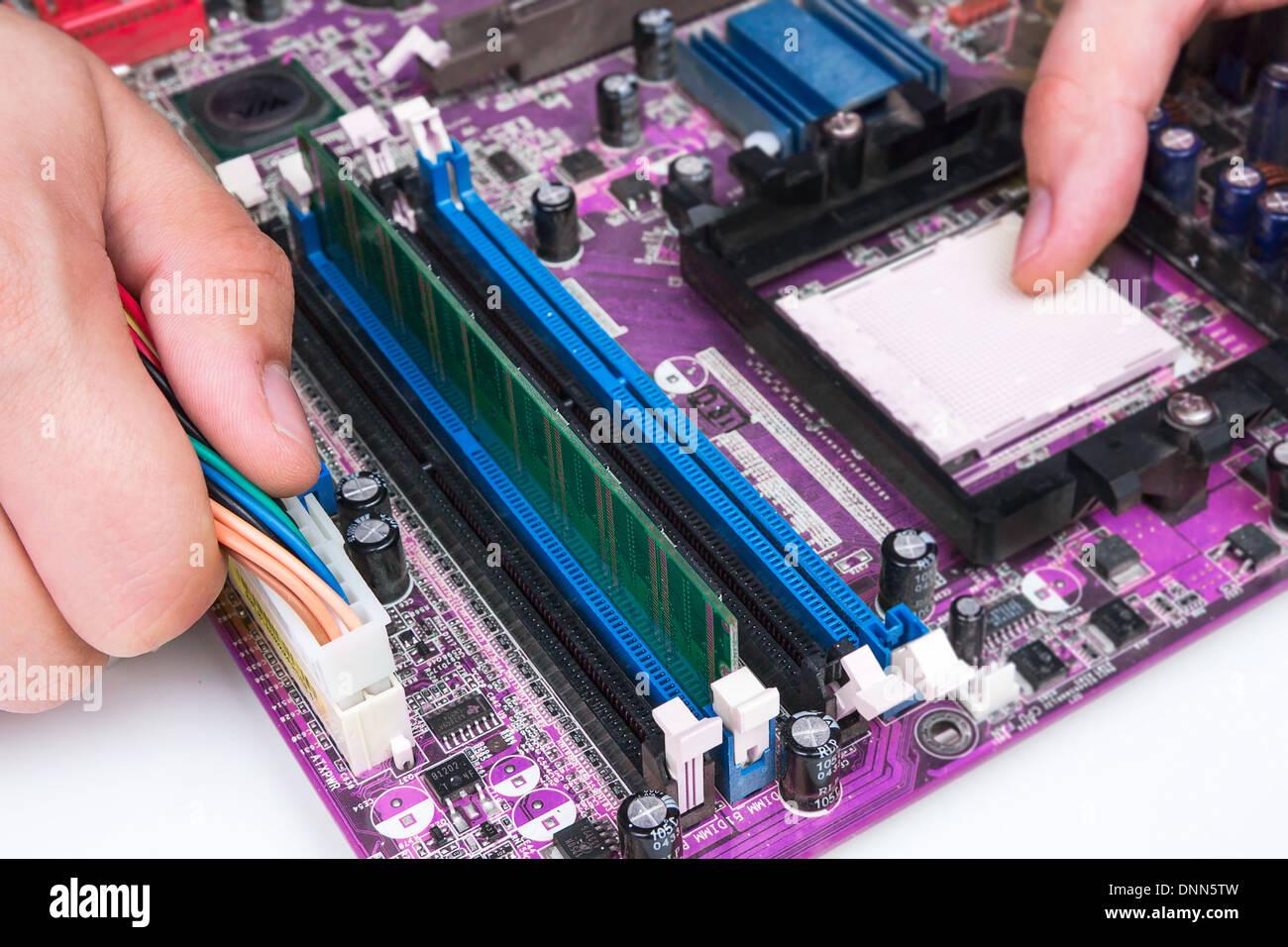 Technician repairing computer hardware - Stock Image