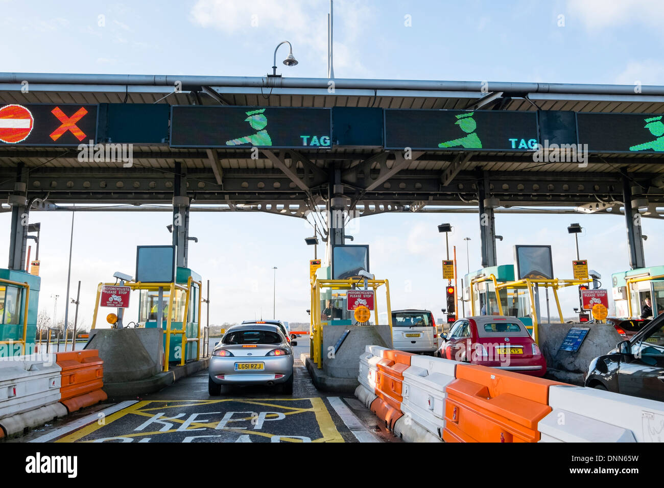 Toll booths on the bridge over the River Severn between England & Wales, UK. Second crossing newer bridge tolls. - Stock Image