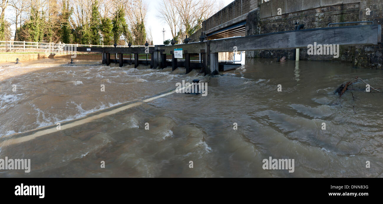The Hampstead lock is overflowing unable to deal with the volume of flood water Yalding flooded rain - Stock Image