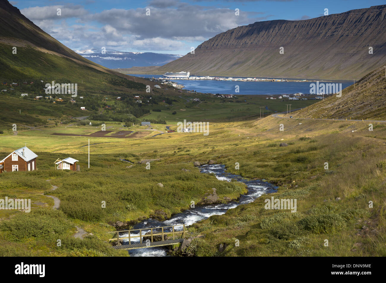 Iceland Isafjordur Westfjords scenic view with Caribbean Princess cruise ship anchored off the town - Stock Image
