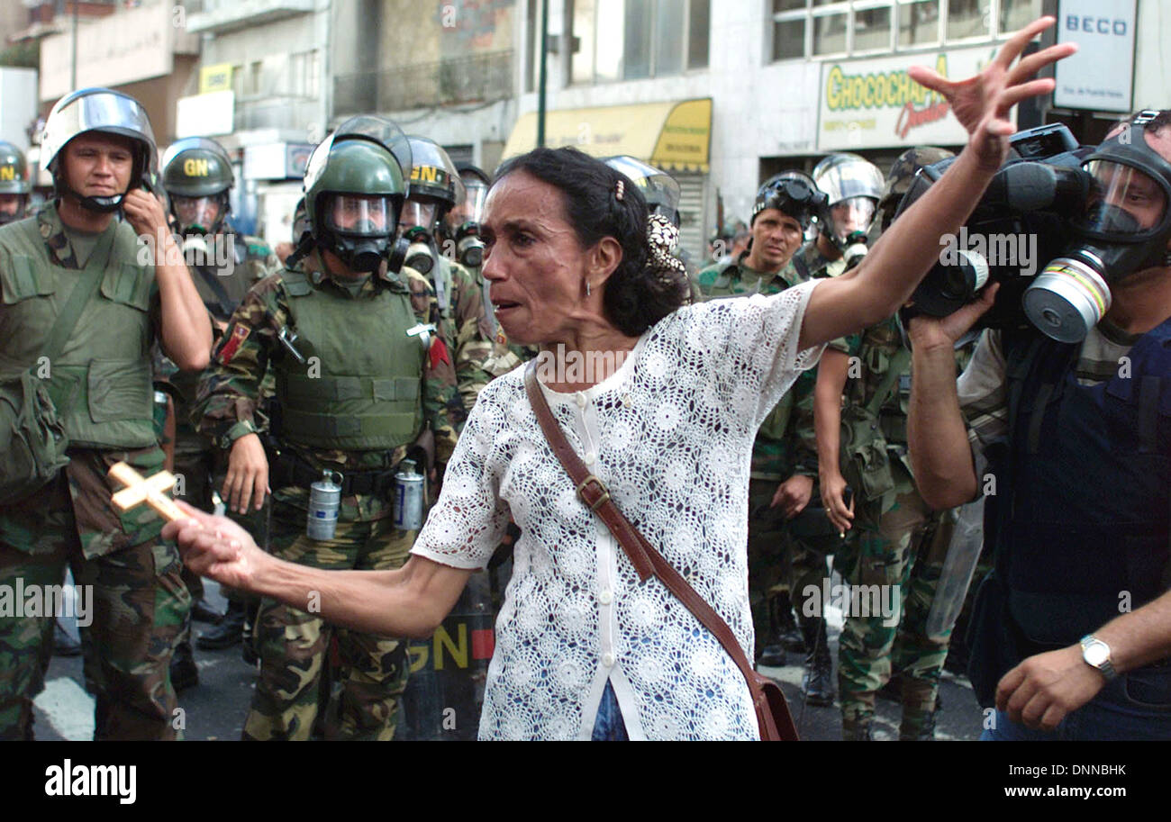 An opposition member yells to national guards during a protests against President Hugo Chavez in Caracas, Venezuela - Stock Image