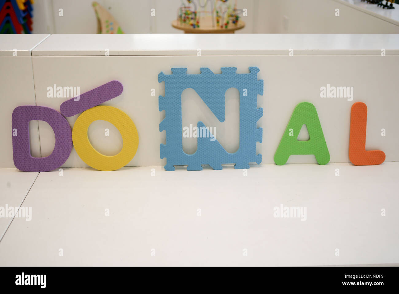 02 January 2014 Belfast, UK Boys' name written in soft floor tiles, Donal is a Irish name. Donal is the Irish name for Daniel - Stock Image