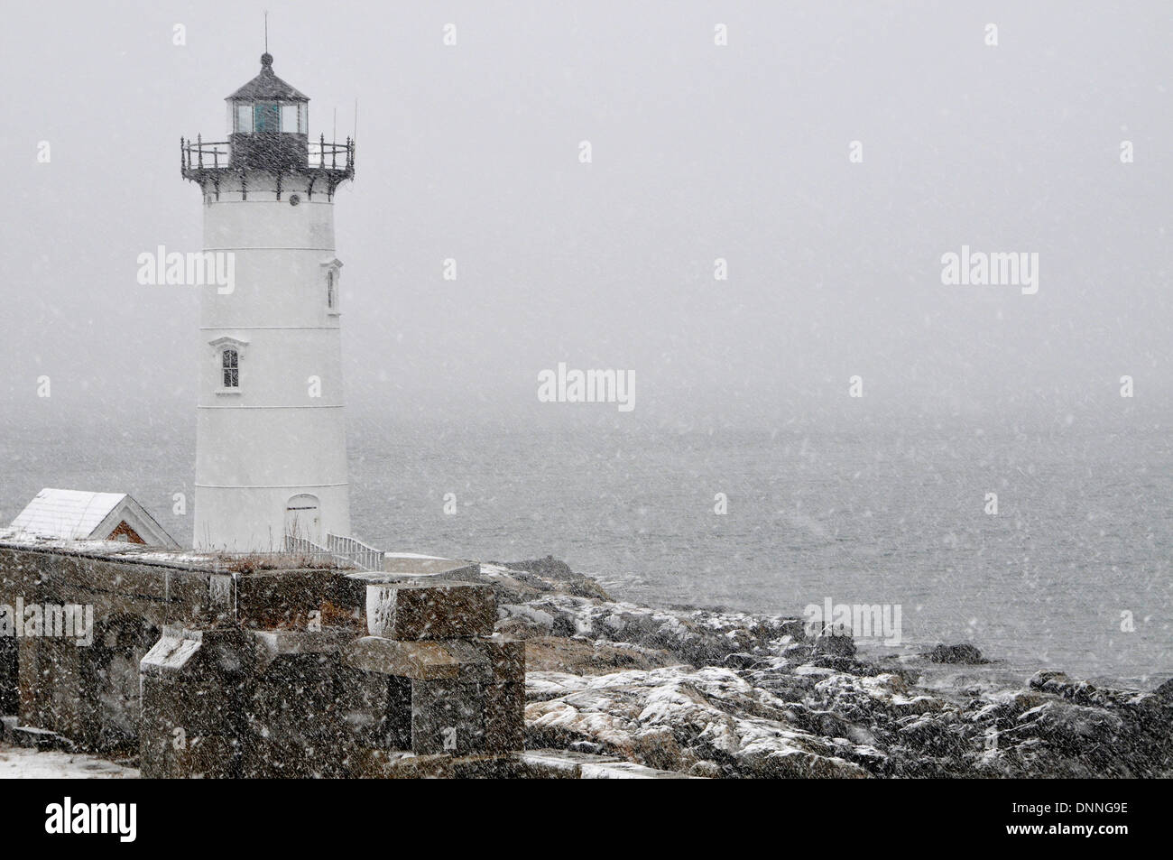 Portsmouth Harbor lighthouse in snowstorm on the New Hampshire coast. - Stock Image