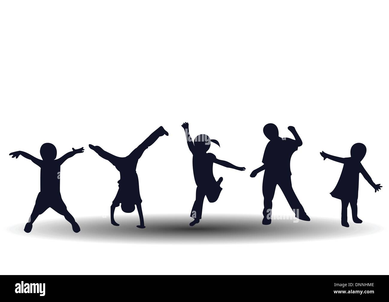 Jumping and playing happy kids - Stock Image