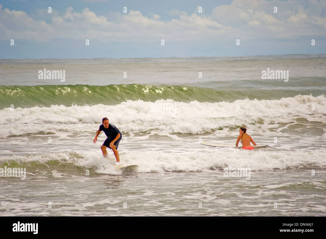 Surfing on the beaches of Dominical, Costa Rica - Stock Image