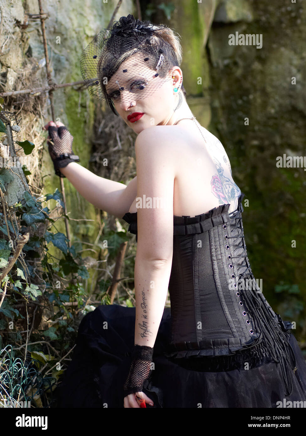 Young woman wearing Steampunk clothing, Victorian style - Stock Image