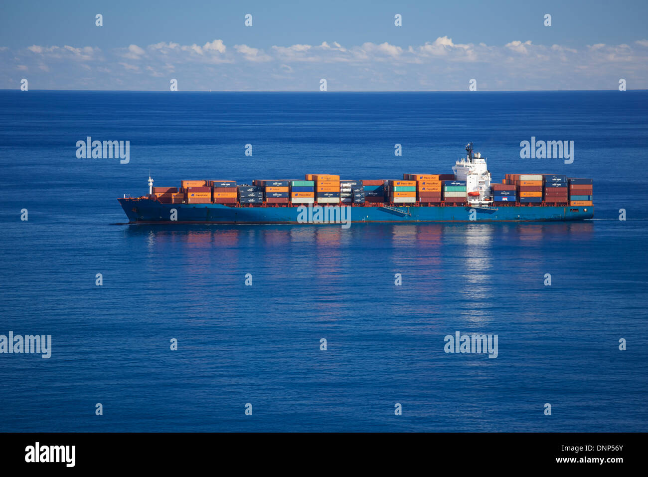 Container ship in the Atlantic Ocean off the island of Madeira - Stock Image