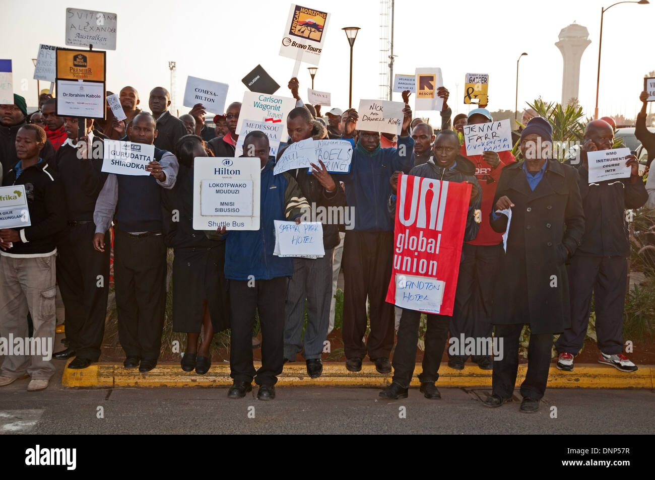 Drivers Guides and Taxi drivers waiting to meet and greet clients outside Jomo Kenyatta International Airport Nairobi - Stock Image