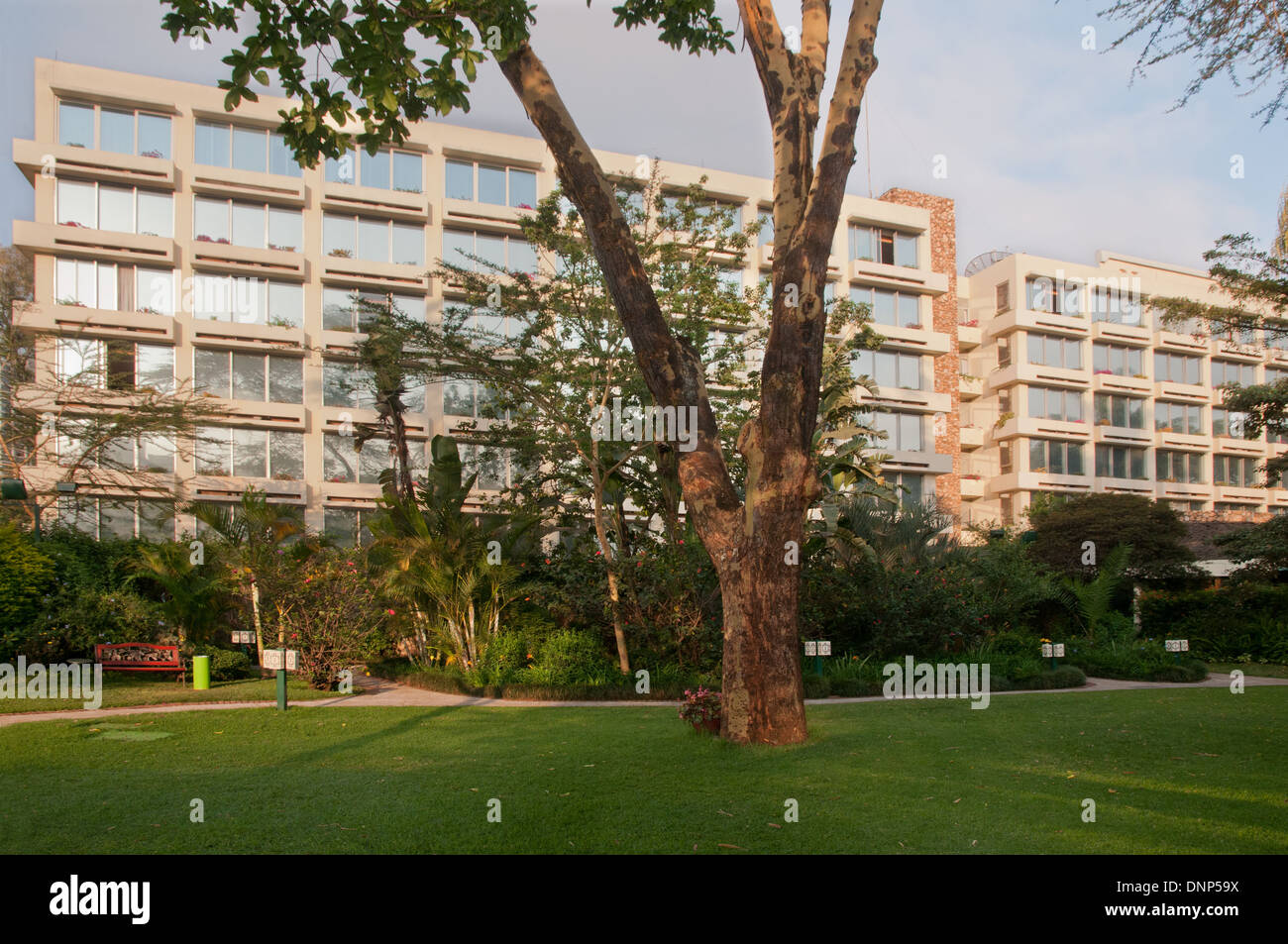 Facade of the Nairobi Serena Hotel seen from the Hotel Garden with green lawns in foreground - Stock Image
