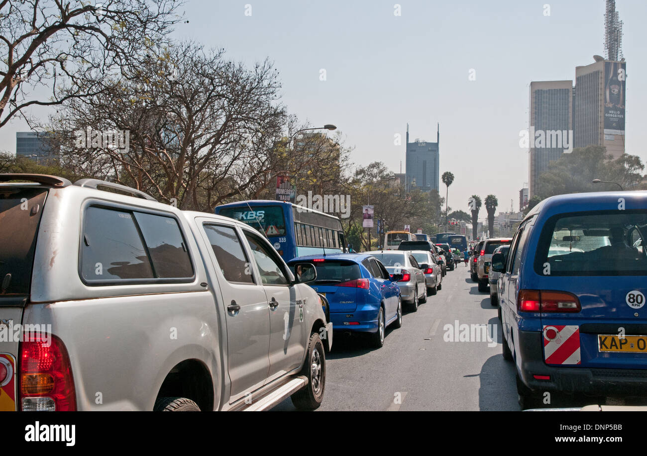 Heavy morning traffic on Kenyatta Avenue Nairobi Kenya with Post Office Tower top right TRAFFIC NAIROBI KENYA - Stock Image