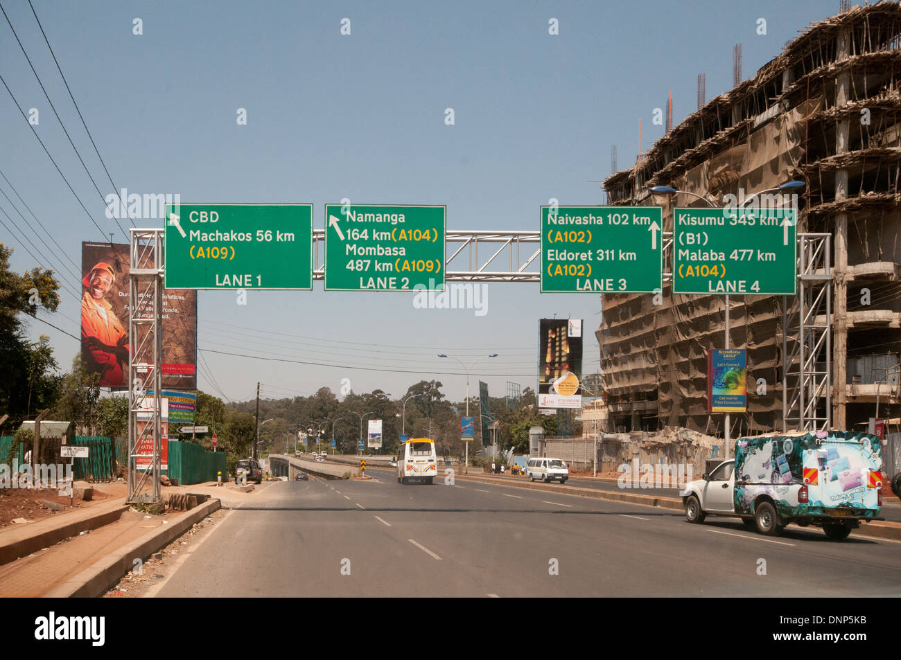 Overhead road signs and new buildings under construction on Forest Road Nairobi Kenya - Stock Image