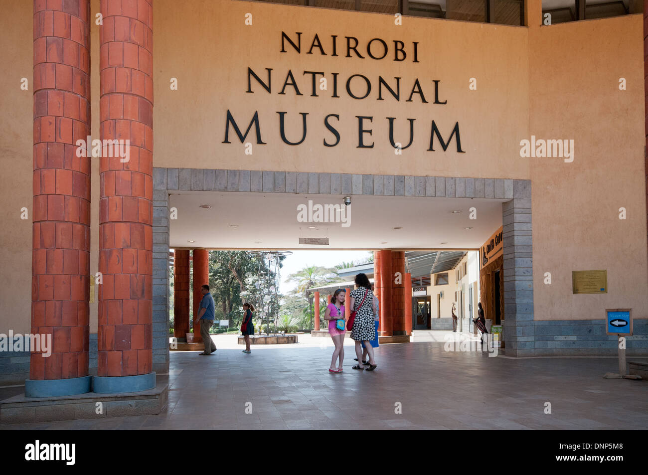 White Caucasian family of adults and children entering the main entrance of the Nairobi National Museum - Stock Image