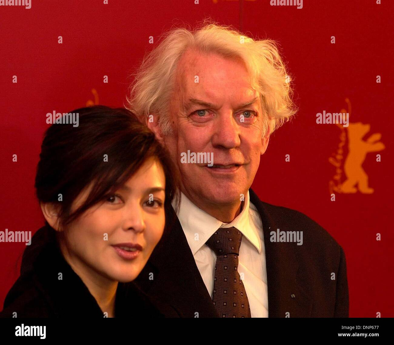 Donald Sutherland and Rosamund Kwan, both actors in the Berlinale film 'Big Shot's Funeral'. - Stock Image