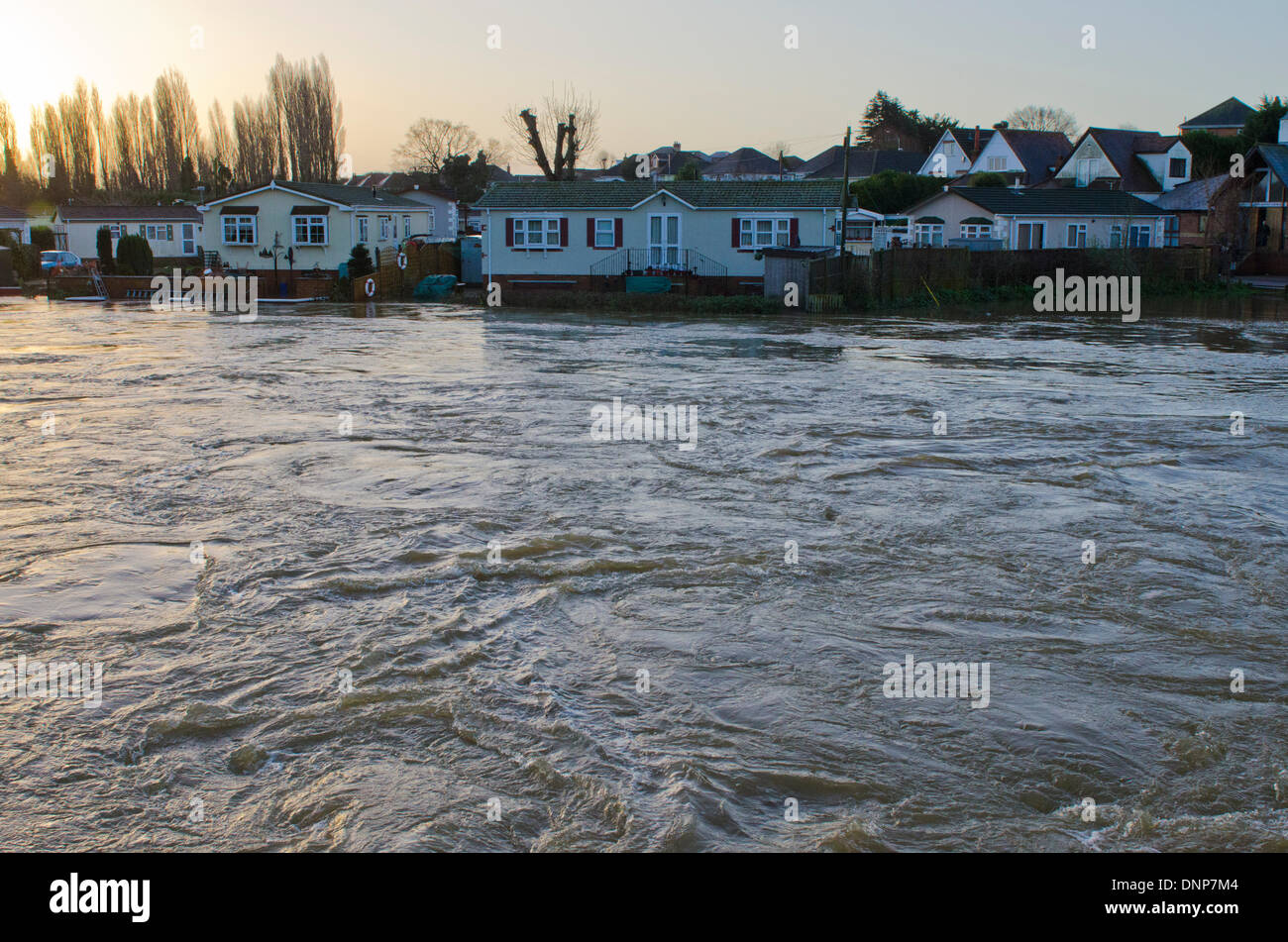 Iford, Christchurch, Dorset, UK. 3rd January 2014. Residents evacuated from the Iford Bridge Home Park site watch water levels rise. - Stock Image
