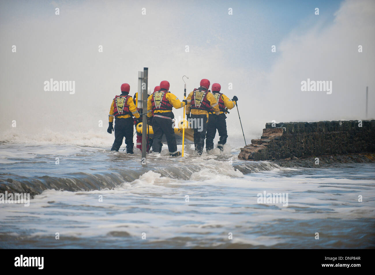 Barmouth, Gwynedd, Wales, UK. 3rd January 2014. Coastguards deal with flooding of Tairheli estate as huge wav es - Stock Image