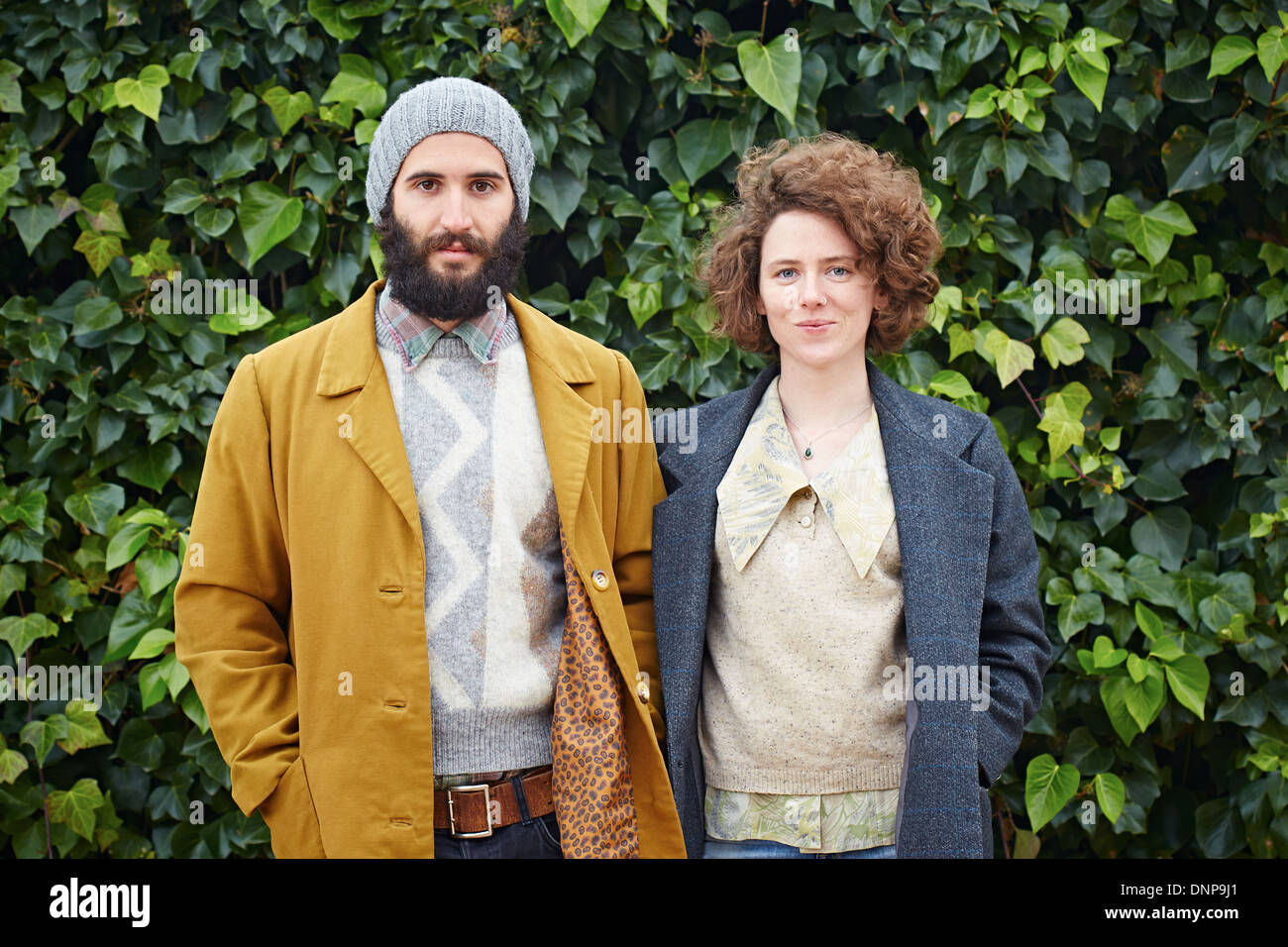 Smiling hipster student couple in vintage clothes - Stock Image
