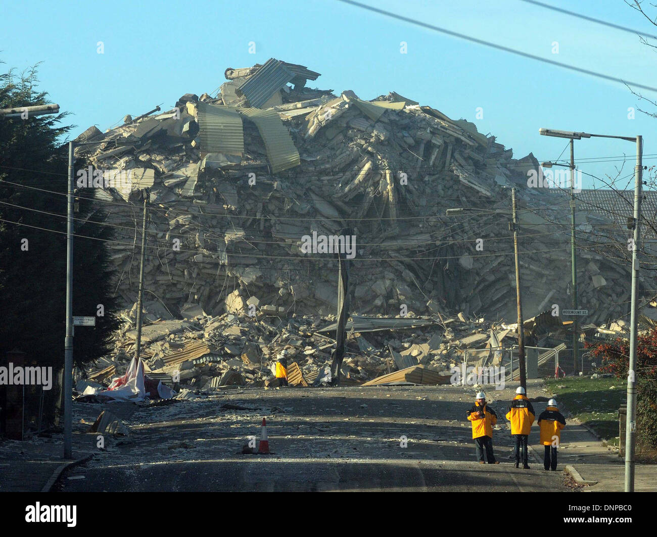 A Glasgow Housing Association multi-storey high rise is demolished on  Roystonhill area of Glasgow. Stock Photo