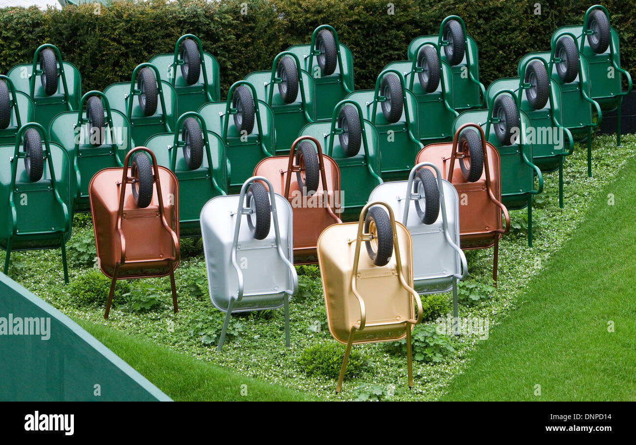 Wheelbarrow art installation Chelsea Flower Show 2013 - Stock Image