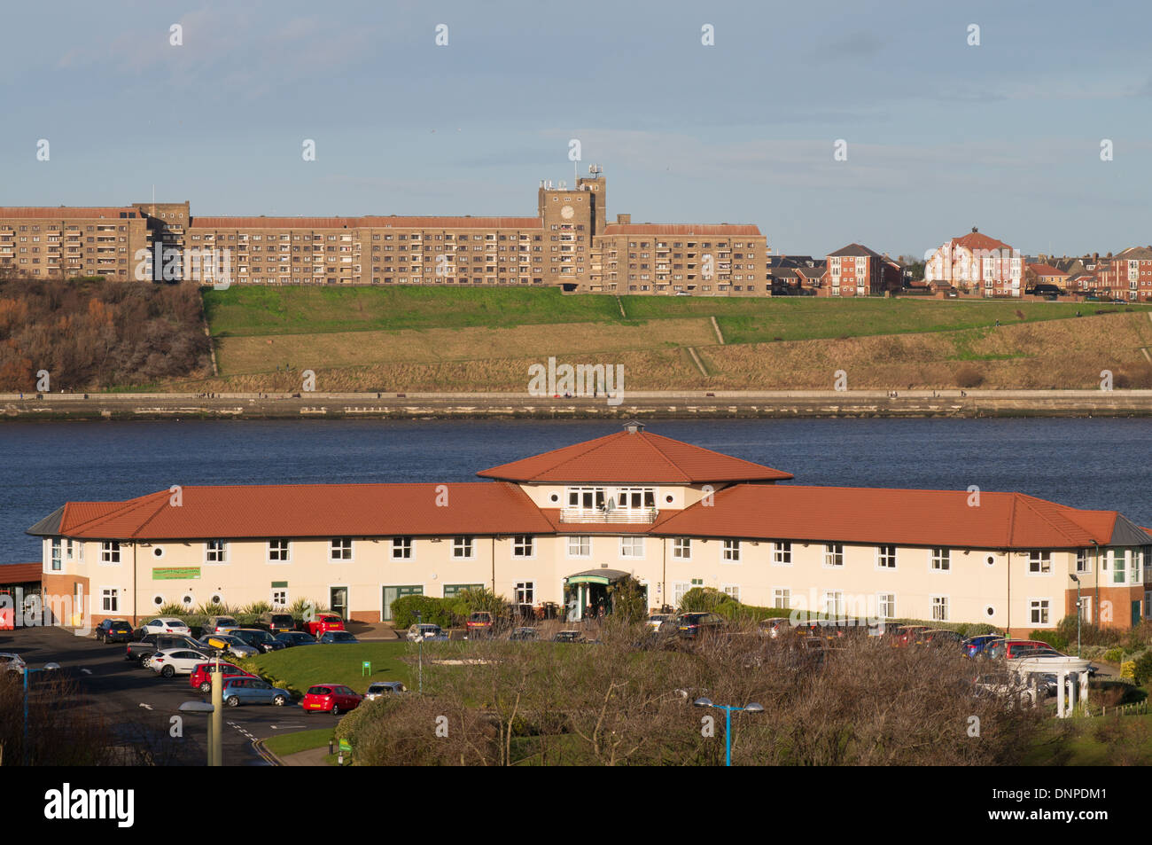 Little Haven Hotel South Shields with Sir James Knott Memorial Flats north Shields in the background, north east England UK - Stock Image