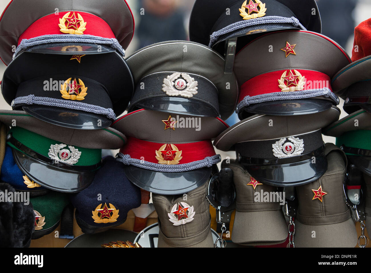 05/12/2013 Russian army caps and fur hats for sale on a market stall, Berlin, Germany - Stock Image