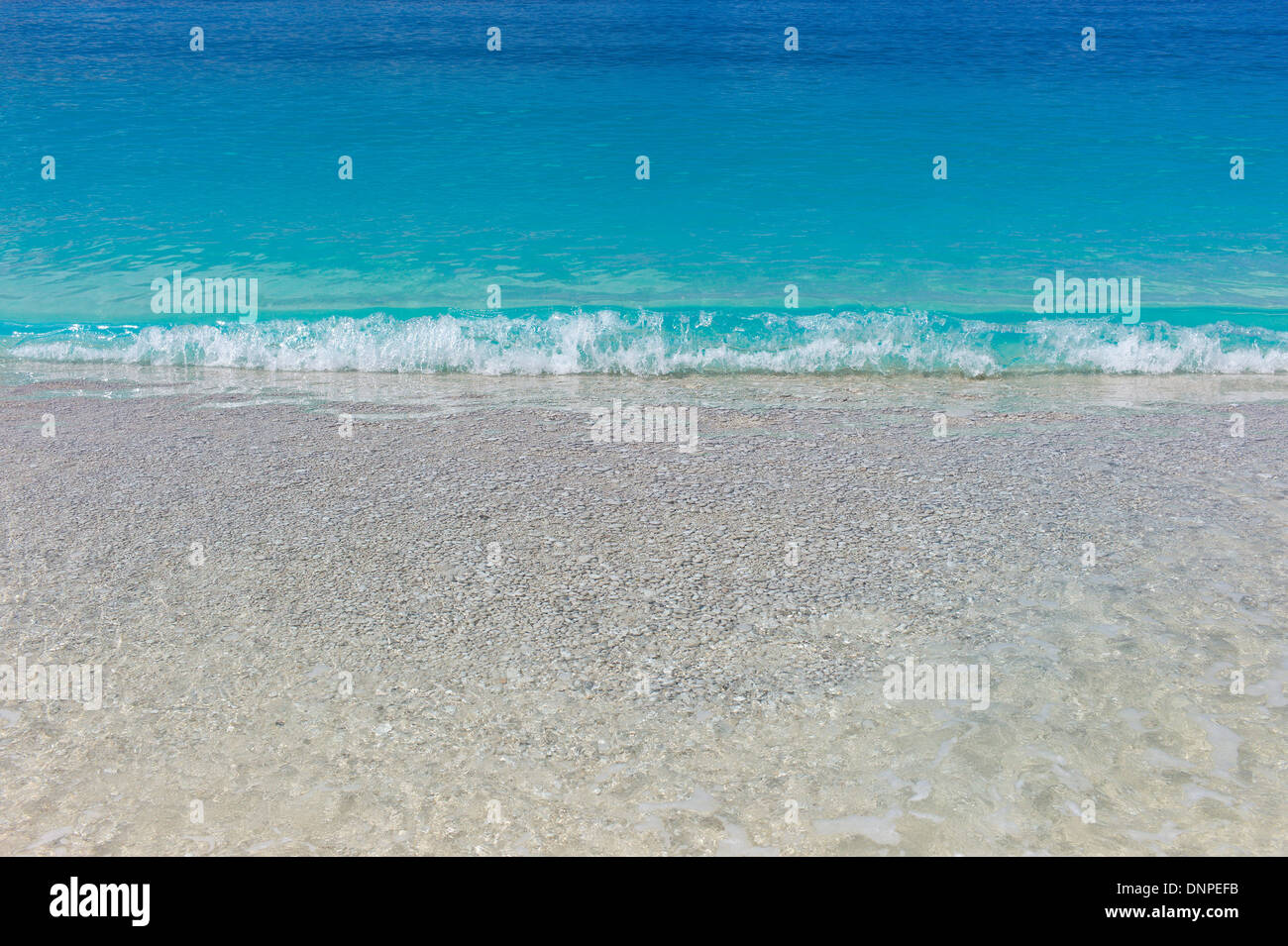 Turquoise blue sea and white pebbles at Myrtos Beach, Cefalonia, Greece - Stock Image