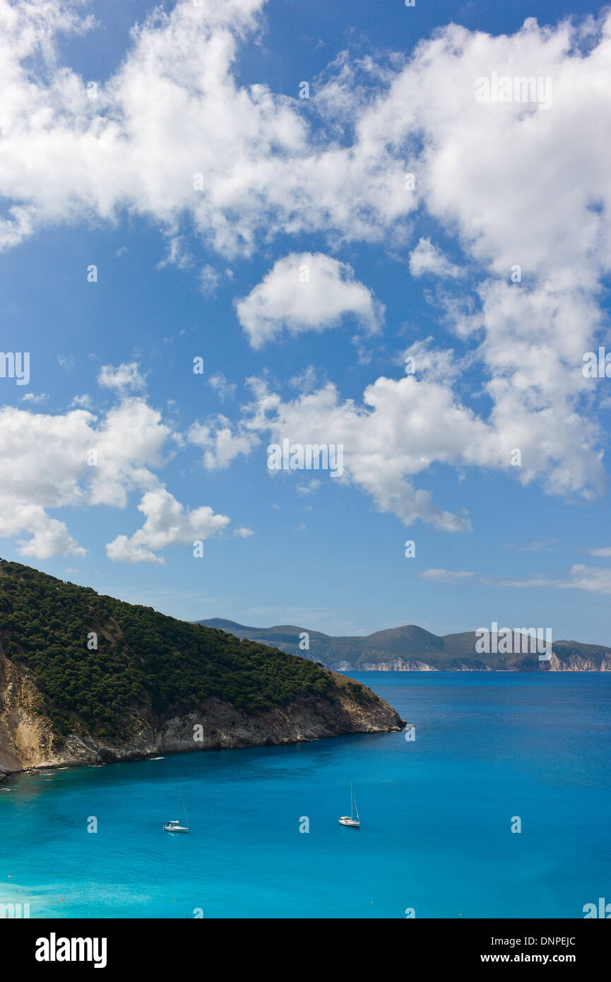 Yachts moored in a blue sea at Mirtos Bay Cefalonia, Greece - Stock Image
