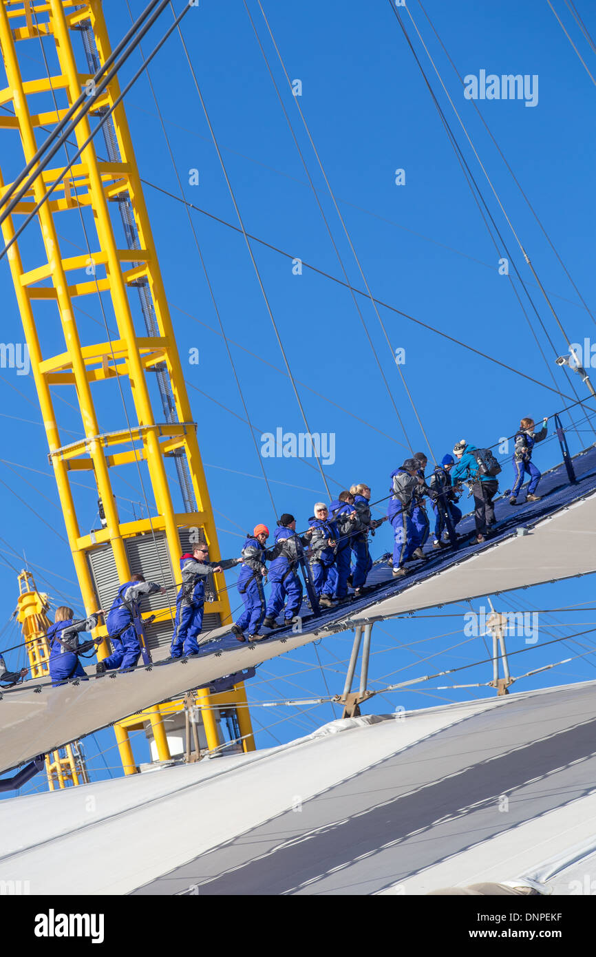 Up at the O2, people climbing the dome roof, Millennium Dome, Greenwich, London Stock Photo