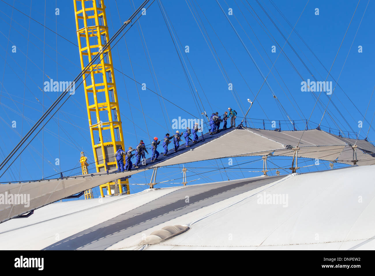 Up at the O2, people climbing the dome roof, Millennium Dome, Greenwich, London - Stock Image