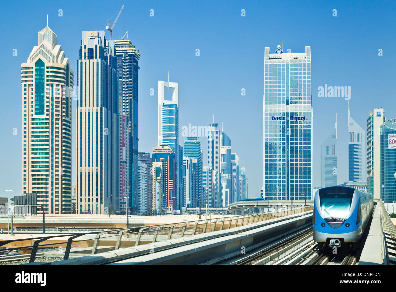 Sheikh Zayed Road skyline high rise skyscrapers, metro train, Dubai City, United Arab Emirates, UAE, Middle east - Stock Image