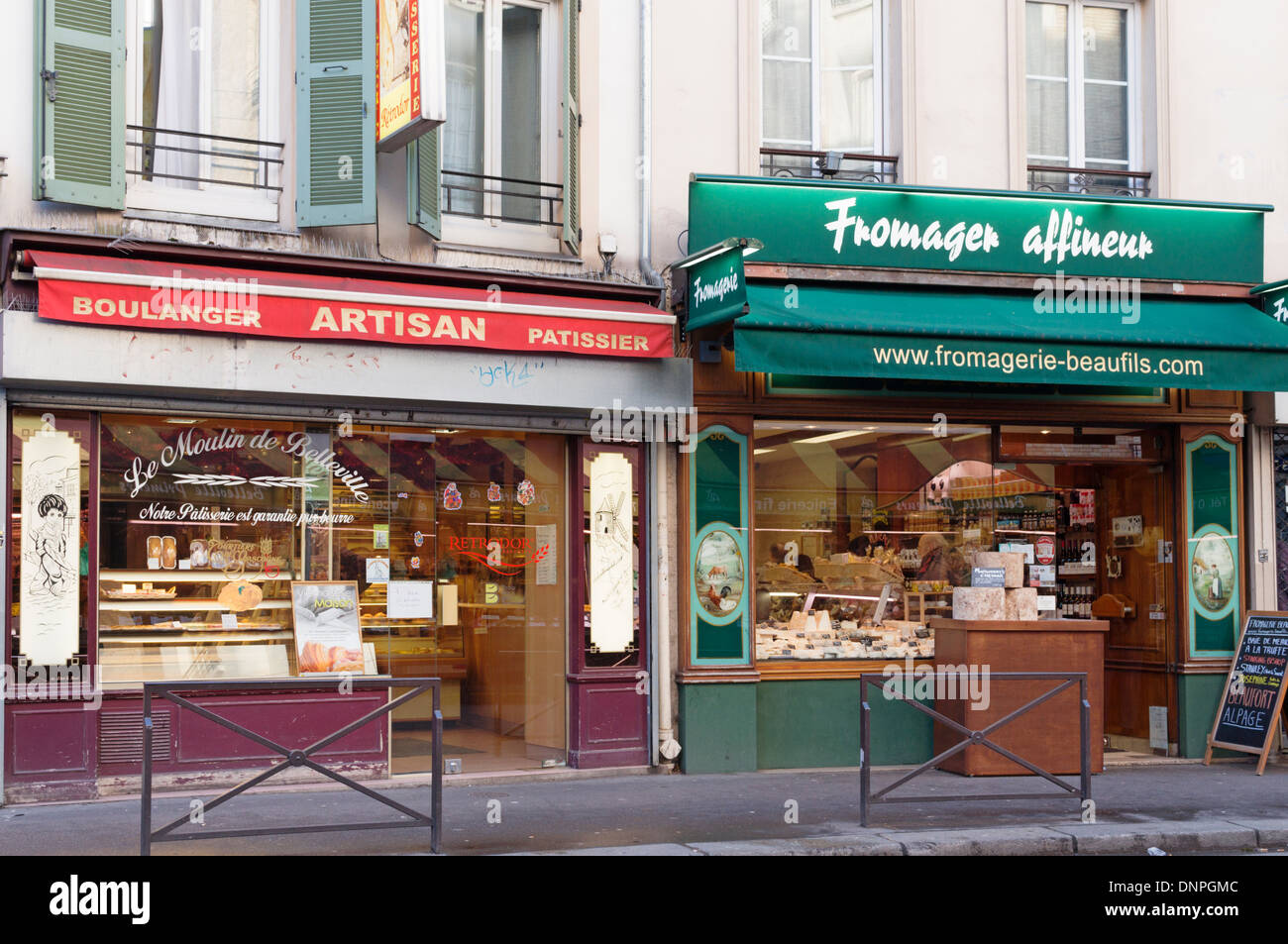 Paris, France - traditional bakery next door to an artisan cheese shop in the Belleville neighbourhood (20th arrondisment) - Stock Image