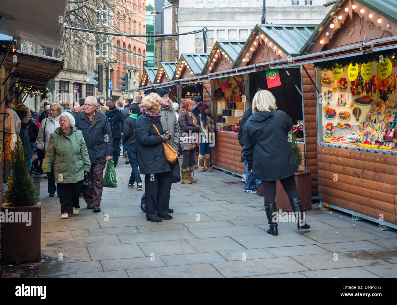 Visitors to Manchester Christmas market in England, UK - Stock Image