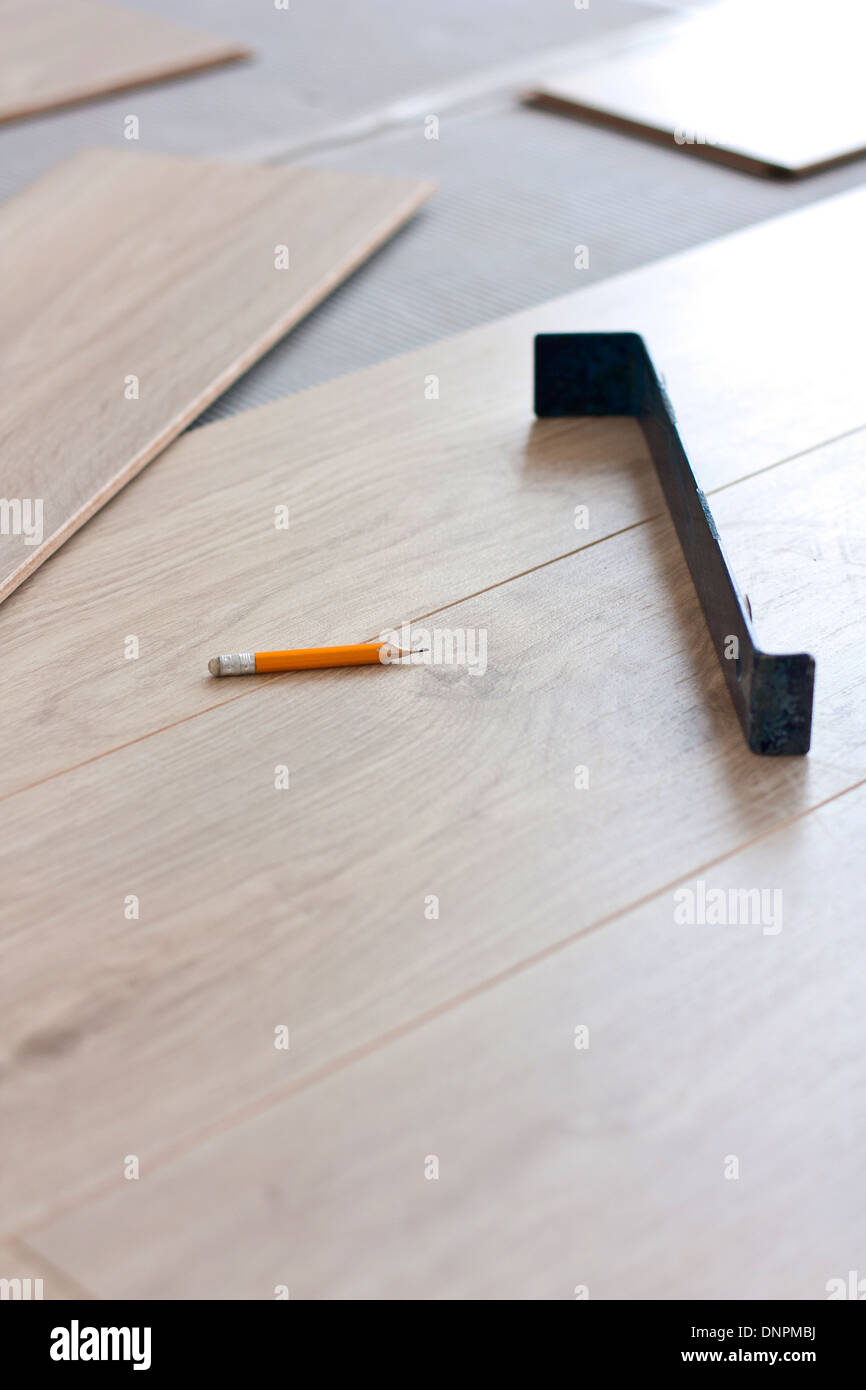 Tool for laying laminate flooring and laminate panels - Stock Image